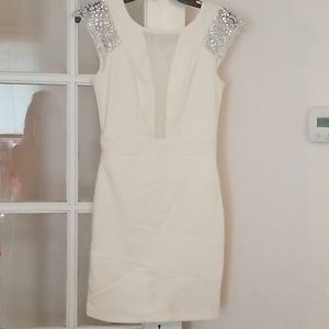 Cocktail dress with sheer chest and rhinestones